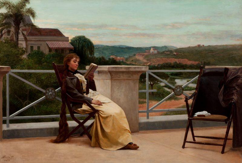 Leitura, Almeida Júnior, 1905. Na pintura, uma mulher, com longos cabelos, senta-se à varanda e lê um livro