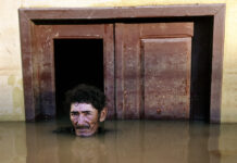 "João Pereira de Araújo photographed by Gideon Mendel for his ""Submerged Portraits"" series."
