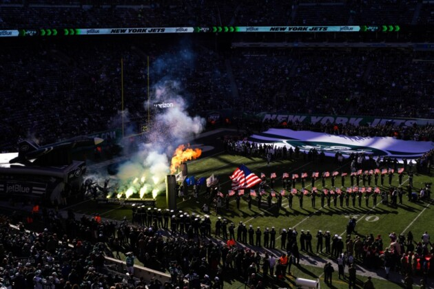 """November is Salute to Service month in the National Football League. Since 2011, the NFL has donated over $34 million to charities that support injured American servicemen. Also since 2011, the NFL has earned approximately $94 billion, which means the amount distributed in support of the military is approximately .03% of the NFL's total revenues. Salute to Service stemmed from an initiative by the Pentagon to boost waning recruitment for the unpopular wars, and since 2009, the Pentagon has given at least $12.2 million to the NFL for propaganda. Senator John McCain conducted an investigation into the practice and released this statement with a detailed report of his findings: """"Americans across the country should be deeply disappoint- ed that many of the ceremonies honoring troops at professional sporting events are not actually being conducted out of a sense of patriotism, but for profit in the form of millions in taxpayer dollars going from the Department of Defense to wealthy pro sports franchises. Fans should have confidence that their hometown heroes are being honored because of their honorable military service, not as a marketing ploy."""" Meadowlands, New Jersey. USA. 2018"""